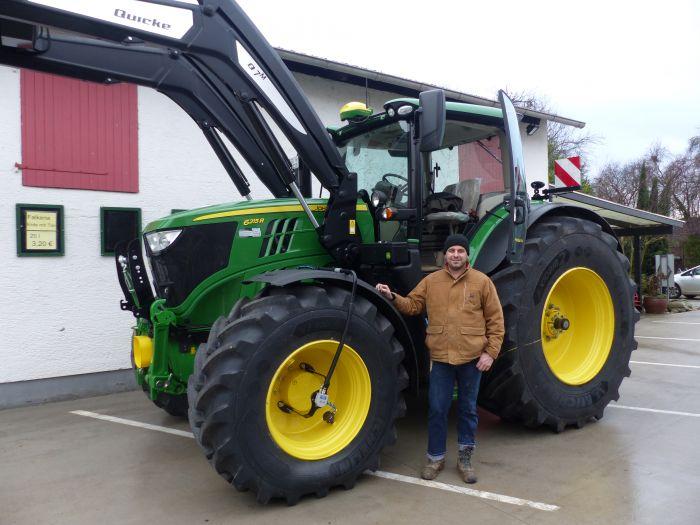 Übergabe JOHN DEERE 6215R Traktor
